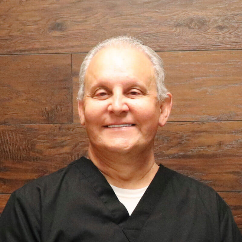 Dr. Kaban smiling in his scrubs